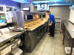 man cleaning Florigo Counter Range