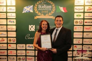 Customer couple winning prize at the Italian Awards